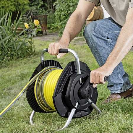 Man Rolling Hose On Hose Reel